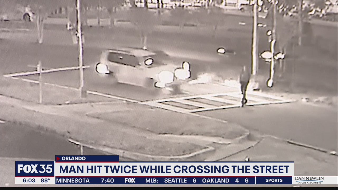 Man hit twice while crossing the street