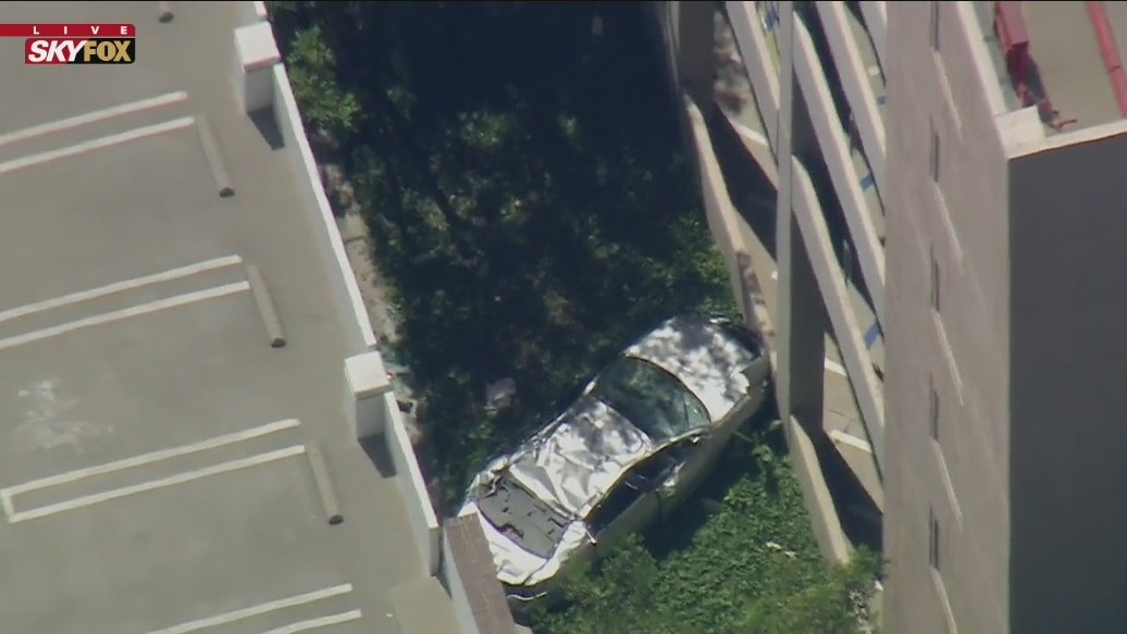 Woman killed after car plunges off 4th story parking structure